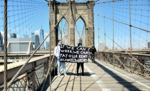 Brooklyn Bridge banner. Liberation photo.