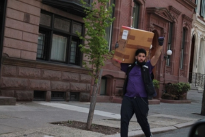 FedEx worker salutes the cancel the rents car caravan, Philadelphia. Liberation Photo.